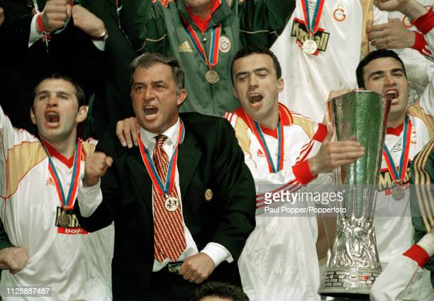 Arif Erdem of Galatasaray celebrates with the trophy alomngside manager Fatih Terim after the 2000 UEFA Cup Final between Galatasaray and Arsenal at...
