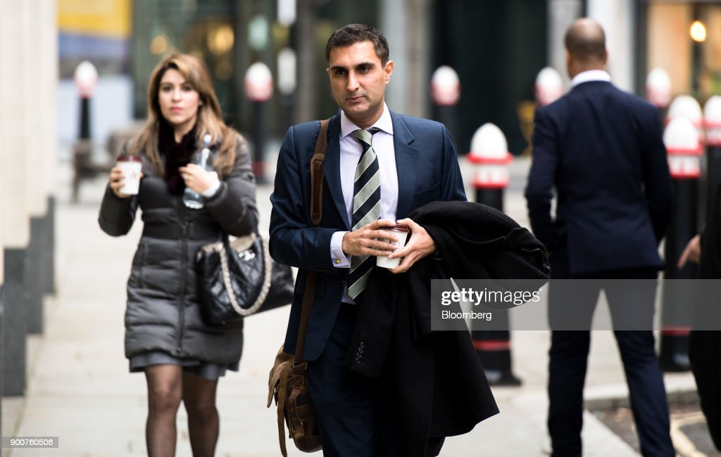 Arif Hussein, a former UBS Group AG trader, center, arrives to challenge a decision by the Financial Conduct Authority (FCA) to ban him from the finance industry, at the Rolls Building in London, U.K., on Wednesday, Jan. 3, 2018. Hussein, who was banned over allegations that he manipulated Libor rates, told the London court that his actions were 'mandated' and 'sanctioned' by the bank. Photographer: Chris J. Ratcliffe/Bloomberg via Getty Images