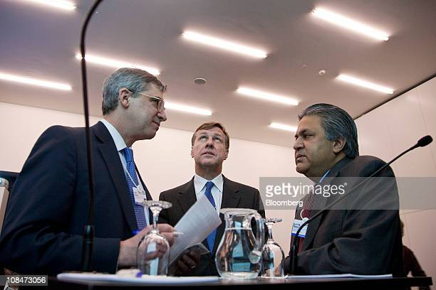 Arif Naqvi chief executive officer of Abraaj Capital right speaks with Martin Senn chief executive officer of Zurich Financial Services AG center and...