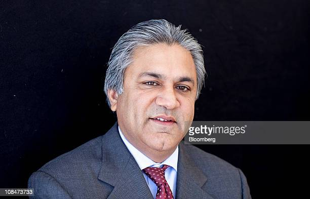 Arif Naqvi chief executive officer of Abraaj Capital stands for a photograph on the third day of the World Economic Forum Annual Meeting 2011 in...