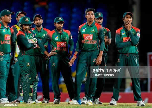 Ariful Haque Mushfiqur Rahim Liton Das Mehidy Hasan Miraz Mustafizur Rahman Tamim Iqbal and Mahmudullah of Bangladesh wait on the 3rd umpire decision...
