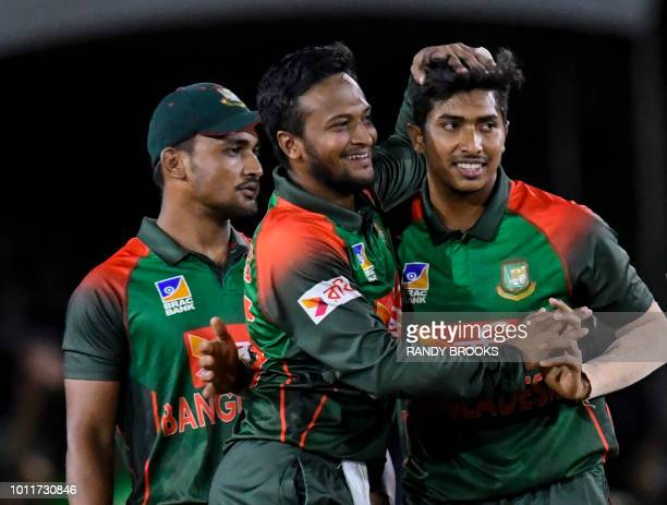 Ariful Haque Shakib Al Hasan and Soumya Sarkar of Bangladesh celebrate the dismissal of Chadwick Walton of West Indies during the 3rd and final T20i...