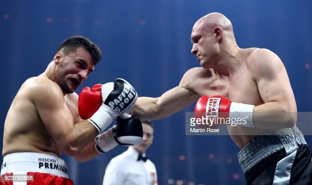 Arijan Sherifi of Germany exchange punches with Yevgeny Makhteienko of Ukraine during their light heavyweigt fight at Arena Nurnberger on February 24...