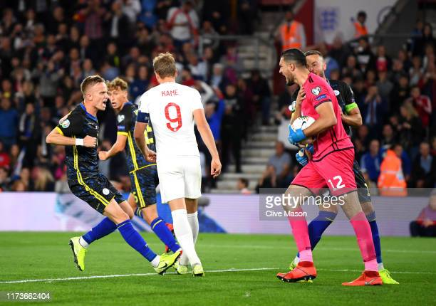 Arijanet Muric of Kosovo is congratulated by team mates after saving a penalty during the UEFA Euro 2020 qualifier match between England and Kosovo...