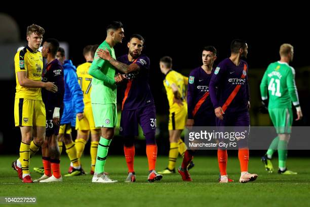 Arijanet Muric of Manchester City celebrates with teammate Nicolas Otamendi of Manchester City following their team's victory in the Carabao Cup...