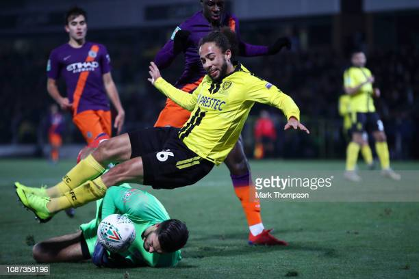 Arijanet Muric of Manchester City saves a shot from Marcus Myers-Harness of Burton Albion during the Carabao Cup Semi Final Second Leg match between...