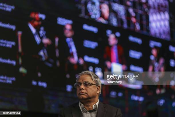 Arijit Basu managing director of State Bank of India pauses during a panel discussion at the Bloomberg India Economic Forum in Mumbai India on...