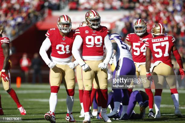 Arik Armstead and DeForest Buckner of the San Francisco 49ers celebrate after making a tackle during the game against the Minnesota Vikings at Levi's...