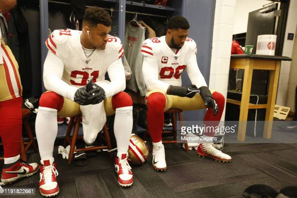 Arik Armstead and DeForest Buckner of the San Francisco 49ers sit in the locker room prior to the game against the Baltimore Ravens at MT Bank...