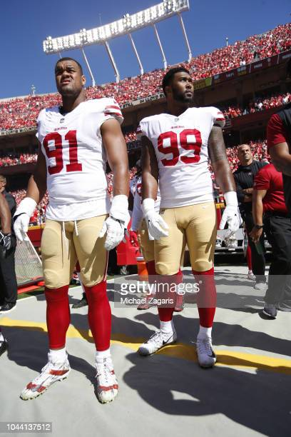 Arik Armstead and DeForest Buckner of the San Francisco 49ers stand on the sideline prior to the game against the Kansas City Chiefs at Arrowhead...