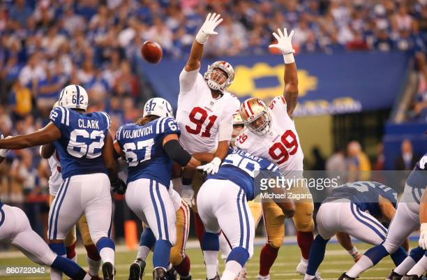 Arik Armstead and DeForest Buckner of the San Francisco 49ers try to block a field goal during the game against the Indianapolis Colts at Lucas Oil...
