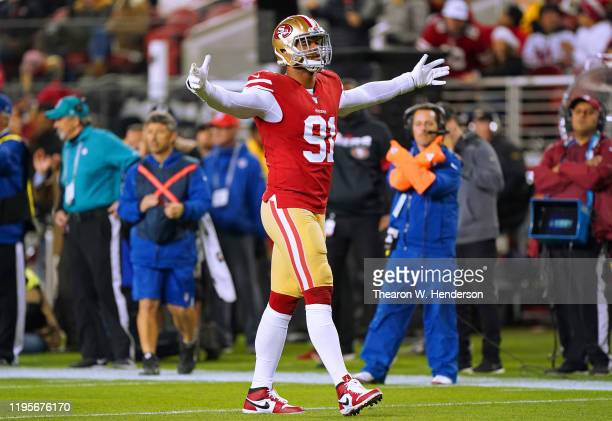 Arik Armstead of the San Francisco 49ers celebrates after making a tackle against the Los Angeles Rams during the first half of an NFL football game...