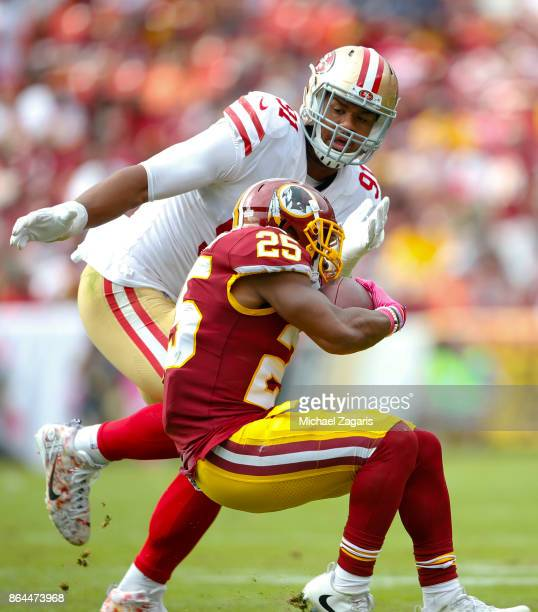 Arik Armstead of the San Francisco 49ers closes in on Chris Thompson of the Washington Redskins during the game at FedEx Field on October 15 2017 in...