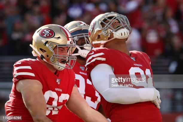 Arik Armstead of the San Francisco 49ers reacts to a sack in the second quarter against the Minnesota Vikings during the NFC Divisional Round Playoff...