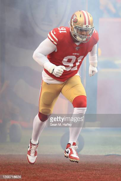 Arik Armstead of the San Francisco 49ers runs onto the field prior to the NFC Championship game against the Green Bay Packers at Levi's Stadium on...