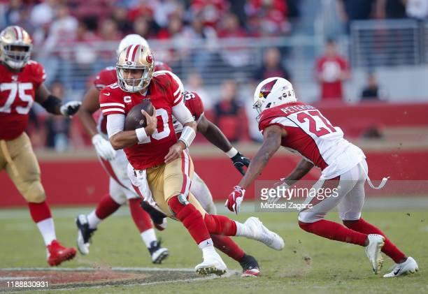 Arik Armstead of the San Francisco 49ers sacks Kyler Murray of the Arizona Cardinals during the game at Levi's Stadium on November 17 2019 in Santa...