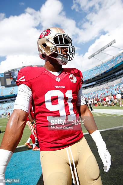 Arik Armstead of the San Francisco 49ers stands on the field prior to the game against the Carolina Panthers at Bank of America Stadium on September...