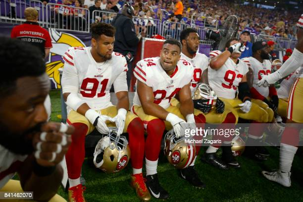 Arik Armstead Solomon Thomas and DeForest Buckner of the San Francisco 49ers sit on the bench during the game against the Minnesota Vikings at US...