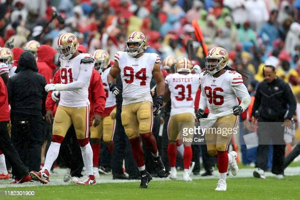Arik Armstead Solomon Thomas and Sheldon Day of the San Francisco 49ers celebrate a defensive play against the Washington Redskins during the first...