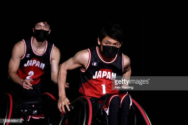 Arika Toyoshima and Renshi Chokai of Team Japan make their way onto the court during the Wheelchair Basketball Men's preliminary round group A match...