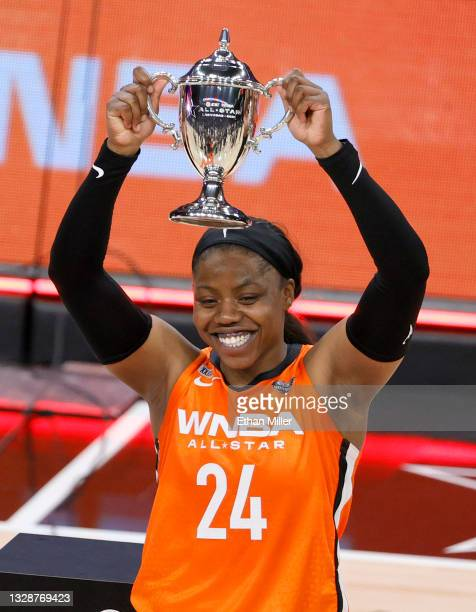 Arike Ogunbowale of Team WNBA holds up the MVP trophy after the 2021 WNBA All-Star Game at Michelob ULTRA Arena on July 14, 2021 in Las Vegas,...