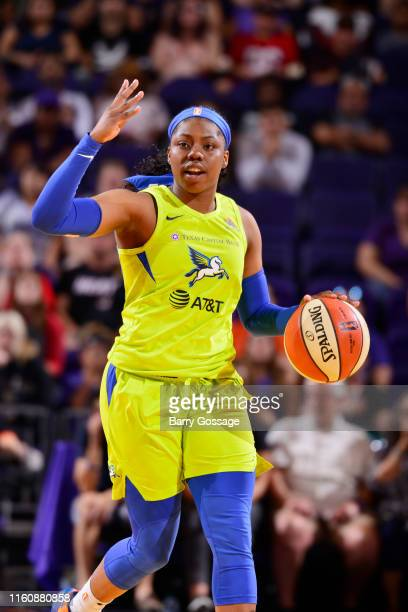 Arike Ogunbowale of the Dallas Wings handles the ball against the Phoenix Mercury on August 10 2019 at the Talking Stick Resort Arena in Phoenix...
