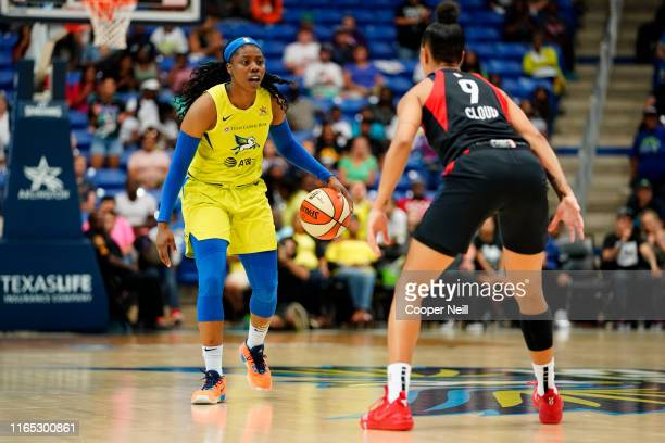 Arike Ogunbowale of the Dallas Wings handles the ball against the Washington Mystics on August 31 2019 at the College Park Arena in Arlington Texas...