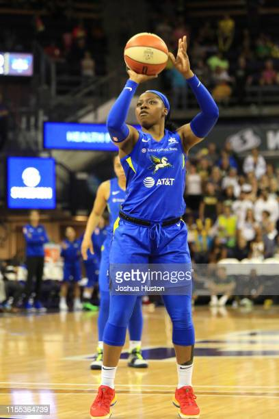 Arike Ogunbowale of the Dallas Wings shoots a free throw during the game against the Seattle Storm on July 12 2019 at the Angel of the Winds Arena in...