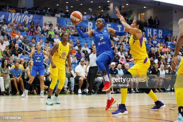 Arike Ogunbowale of the Dallas Wings shoots the ball against the Los Angeles Sparks on August 14 2019 at the College Park Arena in Arlington Texas...