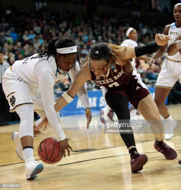 Arike Ogunbowale of the Notre Dame Fighting Irish and Chennedy Carter of the Texas AM Aggies scramble for possession of a loose ball during the 2018...