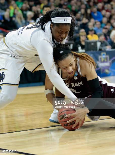 Arike Ogunbowale of the Notre Dame Fighting Irish and Chennedy Carter of the Texas AM Aggies battle for possession of the ball during the 2018 NCAA...
