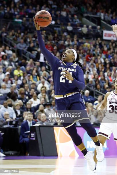 Arike Ogunbowale of the Notre Dame Fighting Irish attempts a lay up against the Mississippi State Lady Bulldogs during the third quarter in the...