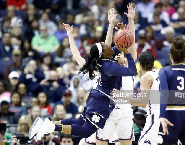 Arike Ogunbowale of the Notre Dame Fighting Irish attempts a shot against the Connecticut Huskies during the second half in the semifinals of the...