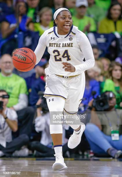 Arike Ogunbowale of the Notre Dame Fighting Irish brings the ball up court during the game against the Connecticut Huskies at Purcell Pavilion on...