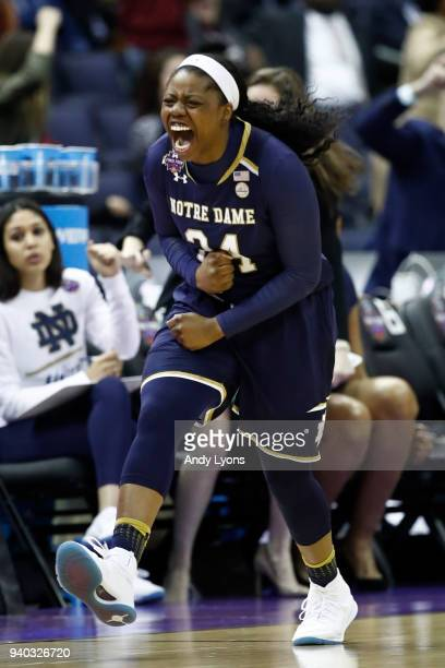 Arike Ogunbowale of the Notre Dame Fighting Irish celebrates after hitting a three point basket against the Notre Dame Fighting Irish late in the...