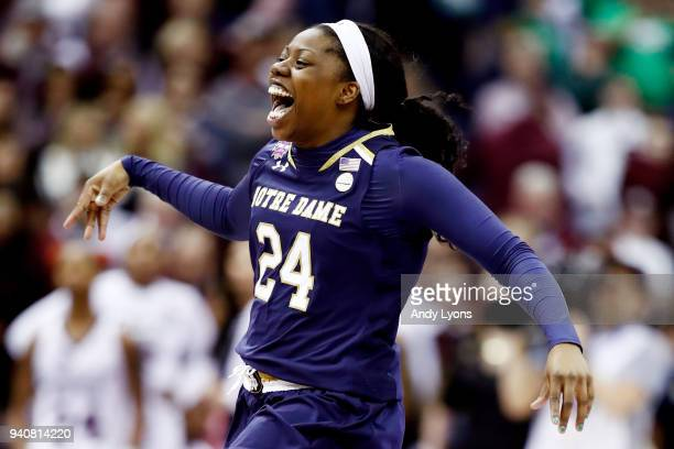Arike Ogunbowale of the Notre Dame Fighting Irish celebrates after scoring the game winning basket with 01 seconds remaining in the fourth quarter to...