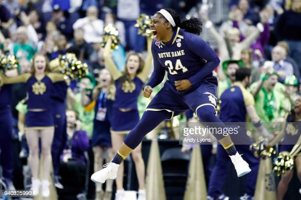 Arike Ogunbowale of the Notre Dame Fighting Irish celebrates her game winning basket with one second left in overtime against the Connecticut Huskies...