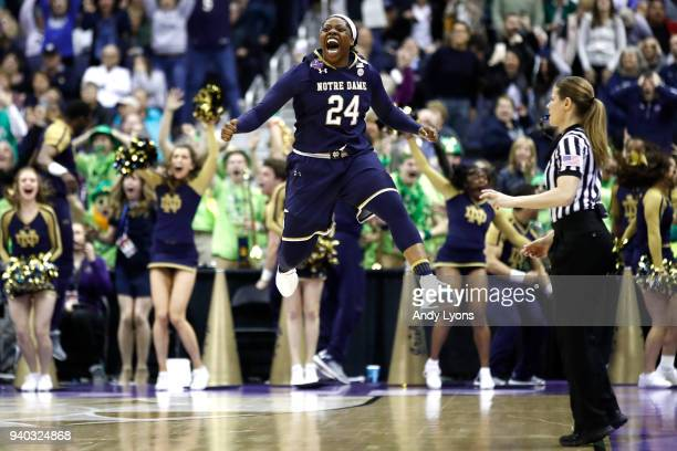 Arike Ogunbowale of the Notre Dame Fighting Irish celebrates her basket during overtime against the Connecticut Huskies in the semifinals of the 2018...