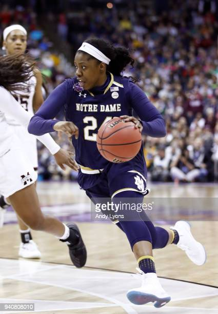 Arike Ogunbowale of the Notre Dame Fighting Irish controls ball against the Mississippi State Lady Bulldogs during the third quarter in the...