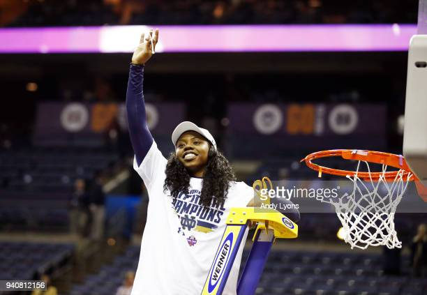 Arike Ogunbowale of the Notre Dame Fighting Irish cuts down the net after scoring the game winning basket to defeat the Mississippi State Lady...