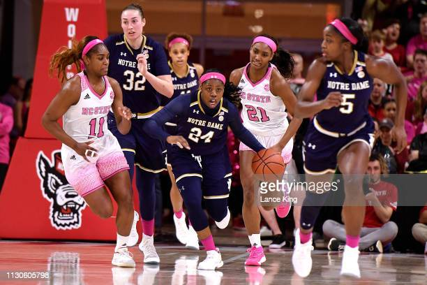 Arike Ogunbowale of the Notre Dame Fighting Irish dribbles up court against the North Carolina State Wolfpack in the second half at Reynolds Coliseum...