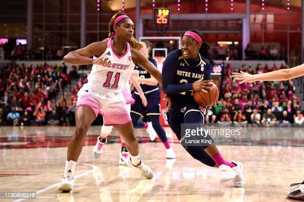 Arike Ogunbowale of the Notre Dame Fighting Irish drives against Kiara Leslie of the North Carolina State Wolfpack in the second half at Reynolds...