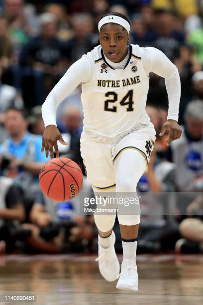Arike Ogunbowale of the Notre Dame Fighting Irish handles the ball on offense against the UConn Huskies during the second quarter in the semifinals...