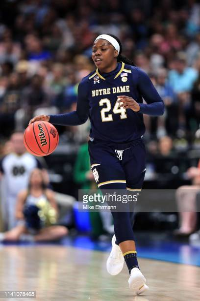 Arike Ogunbowale of the Notre Dame Fighting Irish handles the ball on offense against the Baylor Lady Bears during the first quarter in the...