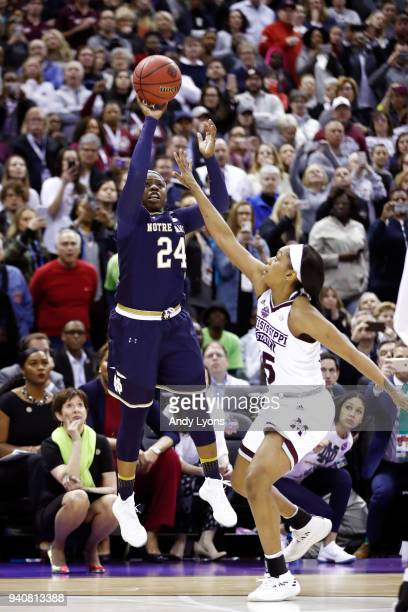 Arike Ogunbowale of the Notre Dame Fighting Irish hits the game winning shot with 0.1 seconds remaining in the fourth quarter under pressure from...