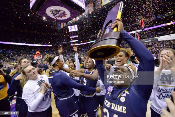 Arike Ogunbowale of the Notre Dame Fighting Irish holds the championship trophy during the Championship Game against the Mississippi State Lady...