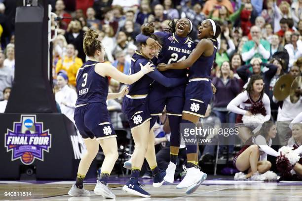 Arike Ogunbowale of the Notre Dame Fighting Irish is congratulated by her teammates Marina Mabrey, Kathryn Westbeld and Jackie Young after scoring...