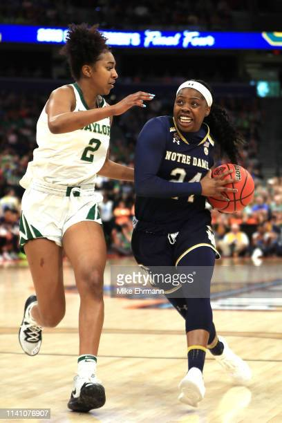Arike Ogunbowale of the Notre Dame Fighting Irish is defended by DiDi Richards of the Baylor Lady Bears during the first quarter in the championship...
