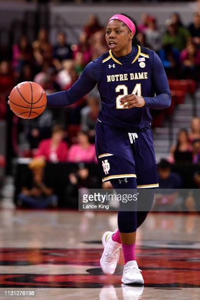 Arike Ogunbowale of the Notre Dame Fighting Irish moves the ball against the North Carolina State Wolfpack at Reynolds Coliseum on February 18 2019...