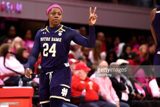 Arike Ogunbowale of the Notre Dame Fighting Irish reacts against the North Carolina State Wolfpack in the first half at Reynolds Coliseum on February...